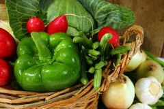 Fresh garden vegetables. In a wicker basket stock photos