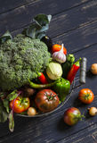 Fresh garden vegetables - broccoli, zucchini, eggplant, peppers, beets, tomatoes, onions, garlic - in vintage  metal basket Royalty Free Stock Photography