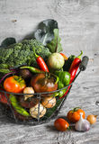 Fresh garden vegetables - broccoli, zucchini, eggplant, peppers, beets, tomatoes, onions, garlic - vintage metal basket Stock Photos