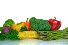 Fresh garden vegetables. Colorful garden vegetables on a shiny surface Royalty Free Stock Image