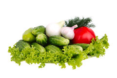 Fresh garden vegetables on plate isolated on white Stock Photo