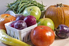 Fresh garden vegetables in a still life. An arrangement of fresh garden vegetables in a harvest still life. A wide variety of produce is represented including Stock Photo