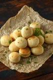 Fresh Garlic Ball bread on black plate on crumpled paper stock photos