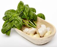 Fresh garlic and basil in a wooden bowl Stock Photo