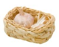 Fresh garlic on a basket isolated on white Stock Photos