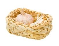 Fresh garlic on a basket isolated on white Royalty Free Stock Images