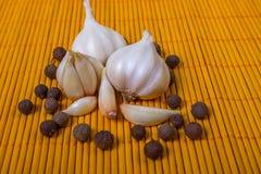 Fresh garlic and black pepper. Garlic. Fresh garlic and black pepper. Garlic clove lying on bamboo Stock Images