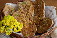 Fresh garlic bread with herbs in basket Stock Images