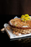 Fresh garlic bread with herbs in basket Stock Photos