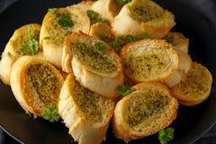 Fresh Garlic Bread, toast on black plate royalty free stock photography