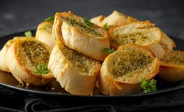 Fresh Garlic Bread, toast on black plate royalty free stock images