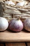 Fresh garlic bulbs 2. Some fresh garlic bulbs on a wooden plate Stock Photo
