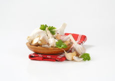 Fresh garlic bulbs and cloves. On wooden plate Royalty Free Stock Image