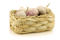 Fresh garlic bulbs in a  woven basket Stock Image