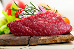 Fresh raw beef cut ready to cook. With vegetables and herbs Royalty Free Stock Image