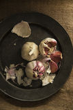 Fresh garlic cloves in moody natural lighting set up with vintag Royalty Free Stock Photos