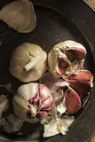 Fresh garlic cloves in moody natural lighting set up with vintag Stock Image