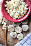 Fresh Garlic Cloves in a Red Bowl Stock Photos
