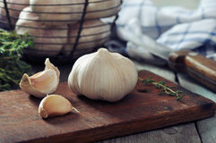 Fresh garlic on cutting board Stock Photo