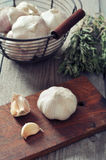 Fresh garlic on cutting board Stock Image