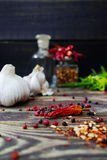 Fresh garlic, dried red hot chili peppers, fresh italian herbs Royalty Free Stock Photography