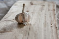 Garlic on a piece of wood Royalty Free Stock Photo