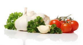 Fresh garlic and tomatoes Stock Photos