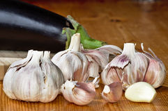 Fresh garlic on wood Stock Images