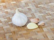 Fresh garlic. On wood background Royalty Free Stock Photos