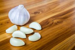 Fresh garlic on a wooden background. Royalty Free Stock Photo