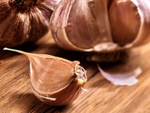 Fresh garlic on  wooden board Stock Image