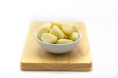 Fresh garlic on wooden board Royalty Free Stock Photos