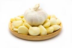 Fresh garlic on wooden dish Stock Photos