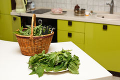 Fresh gathered nettles in basket Stock Photo