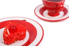 Fresh gelled cake on a plate and red tea Royalty Free Stock Image