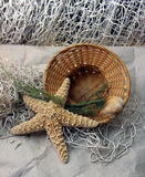 Fresh gentle resort marine still life. With starfish, basket, shell and fishnet Stock Images