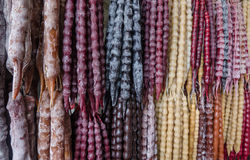Fresh Georgian sweets churchkhela. In different colors hanging on strings royalty free stock photo