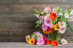 Fresh Gerbera Flowers on Wooden Background Royalty Free Stock Photography