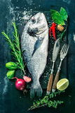 Fresh Gilt-head bream with spices and seasoning Stock Photo