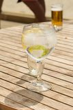 Fresh gin tonic at the beach royalty free stock image