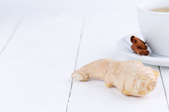 Fresh ginger with cinnamon on wooden table. Royalty Free Stock Image