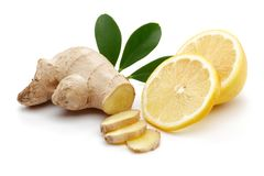 Fresh ginger and lemon with leaves isolated. On white background royalty free stock image