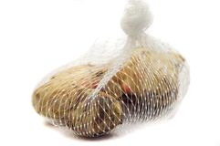 Fresh ginger packed in net bag. Royalty Free Stock Photography