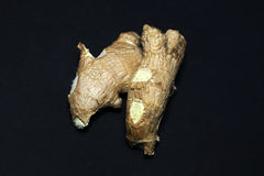 Fresh ginger root on a black background.  Stock Photos