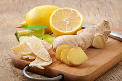 Fresh ginger root, candied ginger and lemon Royalty Free Stock Photos