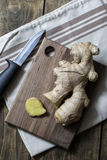 Fresh ginger root on a cutting board Stock Photo