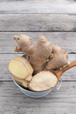 Fresh ginger root and ground ginger spice Stock Image