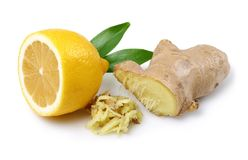 Fresh ginger root with leaves and lemon isolated. On white background royalty free stock image