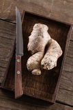 Fresh ginger root on rustic wooden background Stock Images