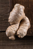 Fresh ginger root on rustic wooden background Stock Photos